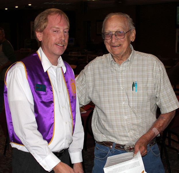Lions President Brian Kline helps congratulate Lion Bill Kunerth (right) for his new member recruitment efforts on behalf of the Belle Fourche Lions Club.