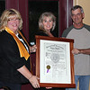 "Northern Lights Lions Club president Joan Manke (left) proudly displays the club's charter document, which will be displayed at  the Belle Fourche Country Club.  With her are ""Mulligan's"" owners Barb and Leigh Moser, who say the charter will be exhibited in a prominent place.          <b>Return to <i> <a href=""http://www.bellefourchelions.org"">Belle Fourche Lions</a> web site</i></b>"