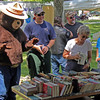 Smokey checks out the Northern Lights Lions Club bargain books.