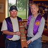 Lion Rick Bartels (left) receives the traveling <b><i>Lion of the Year</b></i> award from Belle Fourche Lions Club president Brian Kline.  Bartels, who served four years as club secretary before assuming the vice-presidency this past year, will become club president for next year.  As <i><b>Lion of the Year</b></i> he joins a long list of fellow Lion who've been honored each year since 1958.  Among other recent winners have been Lions Al Shaw and Rich Drabek.  The award was presented on Thursday, May 24, 2012, at the final club session before a summer recess.    Although the club will have no formal meetings again until next fall, a variety of key projects will be pursued during the summer months, including the All-Car Rally and the Black Hills Roundup, for which Lions have been key participants for many years.