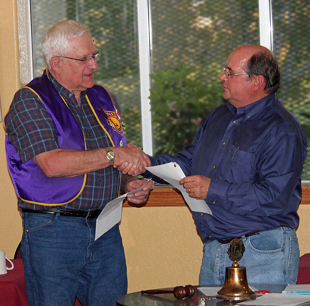 """Club president Ron Ensz (right) congratulates Lion Rich Drabek after presenting him with awards for """"Membership Excellence"""" during the Belle Fourche Lions Club meeting on May 12, 2011.  The awards recognized Drabek for helping to recruit two new members last year (2010)."""