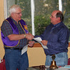 "Club president Ron Ensz (right) congratulates Lion Rich Drabek after presenting him with awards for ""Membership Excellence"" during the Belle Fourche Lions Club meeting on May 12, 2011.  The awards recognized Drabek for helping to recruit two new members last year (2010)."
