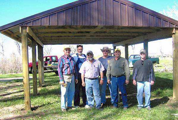 Lions Chuck Snoozy, Tom Nary, Jim Osloond, Gerald Keil, Ron Ensz, and Rik Bartels after completing a picnic shelter along Redwater River in east Belle Fourche.