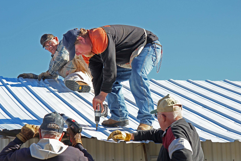 Master driller Rik Bartels does his job as fellow Lions look on.