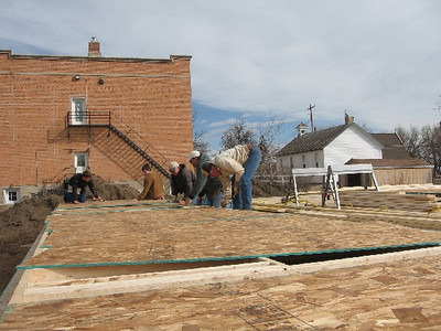 A crew of Lions work on a Habitat for Humanity home across the street from Herrmann Park in Belle Fourche.