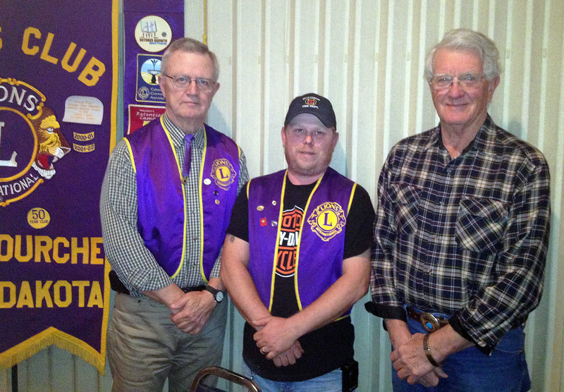 And two more Perfect Attendance award recipients for last year:  Lion Larry Miller (left) and Lion Leo Orme (right) stand beside Belle Fourche Lions President Rik Bartels.