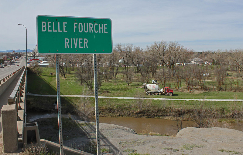 Looking south across the Belle Fourche River on U.S. 85.  You can see the cement truck along the path.