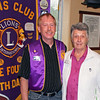 Mary Ellen Warren from the Questers organization (right) poses with Lion president Brian Kline following her May 10, 2012 report to the club about the Johnny Spaulding Cabin.  The Lions Club has a long history with the cabin and is considering a new related construction project at the site near the Tri-State Museum.