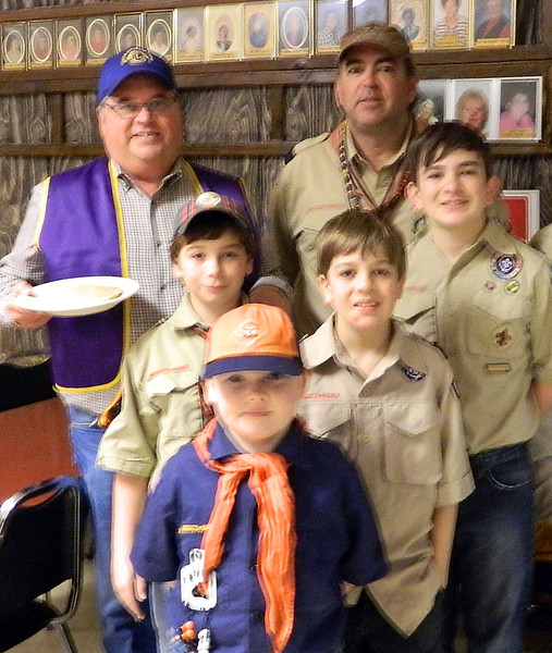 Lions Pancake Chairman Ron Ensz (back left) and Cubmaster Allan Schreier from Pack 19 (back right) behind a group of Pack 19 scouts.