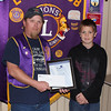 Belle Fourches Lions Club president Rik Bartels presents First Place Winner John Maher with his certificate and $50 prize.