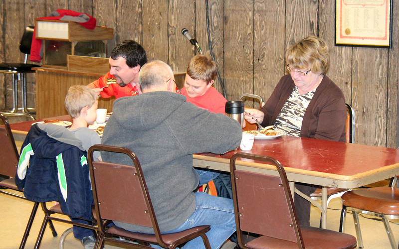 Some happy customers enjoy flapjacks at the Lions Pancake Breakfast.