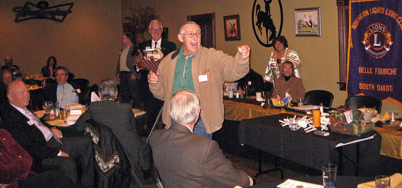 Neil Vollmer of the Newell Lions club served as auctioneer for the evening -- and he obviously was enjoying it!