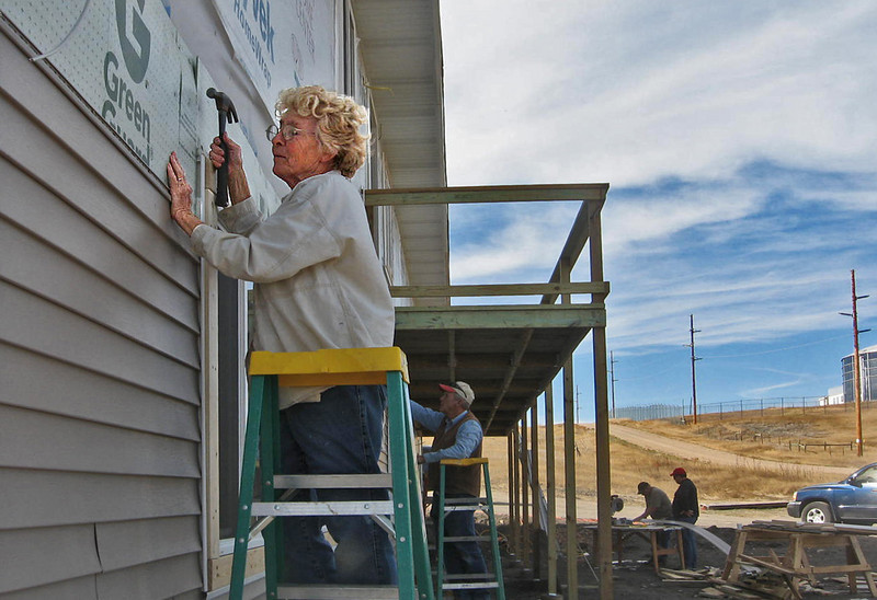 Joyce Drabek, a member of the Norhtern Lights Lions Club is show wielding a hammer on the project.