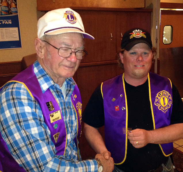 <i><b>SCHNAIBLE RECOGNIZED FOR 37 YEARS SERVICE</b></i>  Lion Bob Schnaible (left) receives a pin for 37 years service as a Lion.  The award was presented by Belle Fourche Lions president Rik Bartels at our May 22, 2014, meeting at The Stadium.  Congratulations Lion Schnaible!