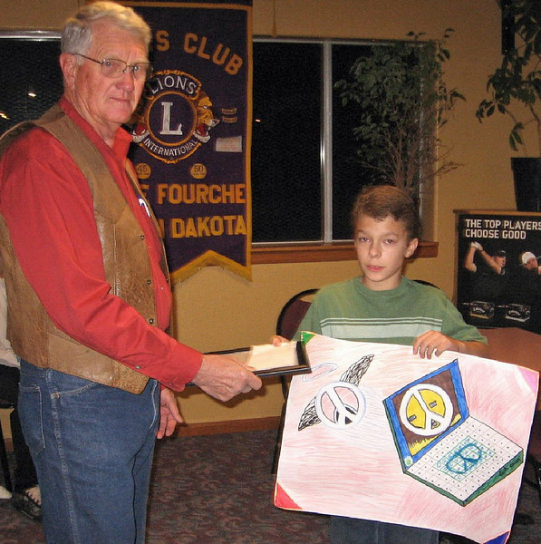 Tristan Barden (at right) copped Second Place in the Peace Poster contest.  President Orme presents the lad with his award, which came with a $25 prize.