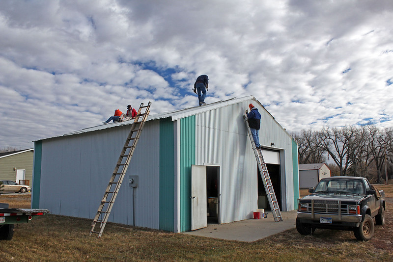 <i><b>LIONS BUILDING GET NEW ROOF</b></i>  The weather was almost perfect for the weekend work project of November 2-3, 2012.   Several Belle Fourche Lions gathered both days to replace the old metal roof atop our Lions building.
