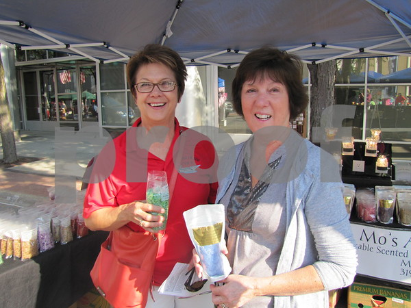 Jill Lawler and Betty Geist check out the variety of scents at Mo's Angel Scents booth.