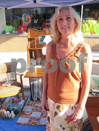 Diana Hanna in her booth filled with antiques at Market on Central.  Hanna refinishes antique furniture.
