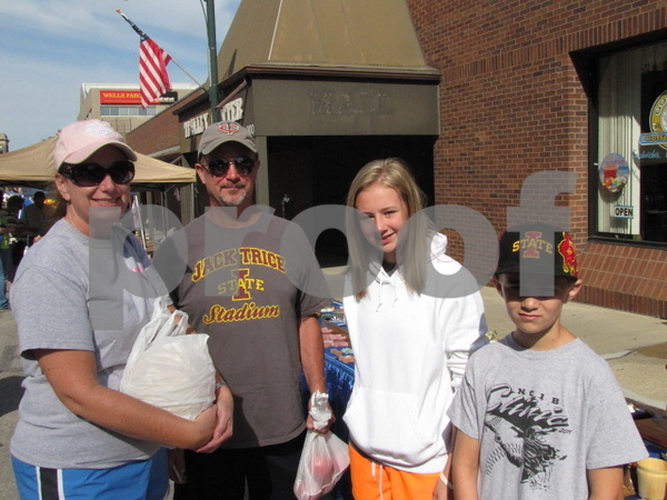 Laura, Eddie, Shelby, and Jared Jacobson with their purchases at Market on Central.