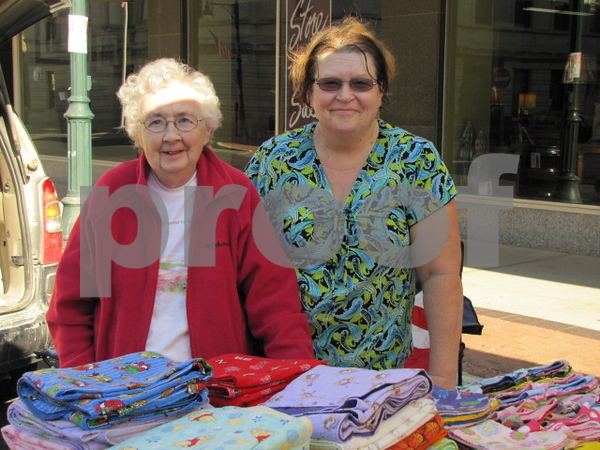 Doris Skeie and her daughter Wanita Kueter at their booth at Market on Central.