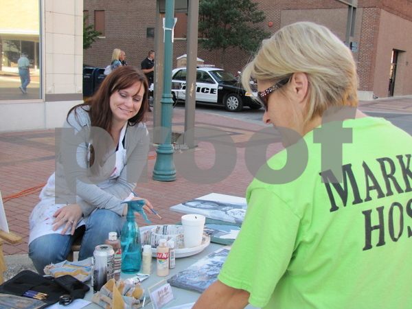 Artist Katrina West visits with 'Market on Central' hostess Laura Eastwood.