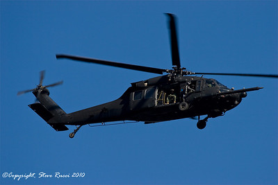 Army Blackhawk helicopter flying over...