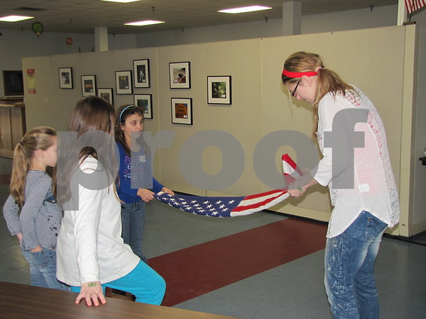 Stacy Lennon talked to the children about etiquette of the American flag and the proper way to fold it.