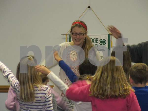 Kids participated in some 4-H camp songs.