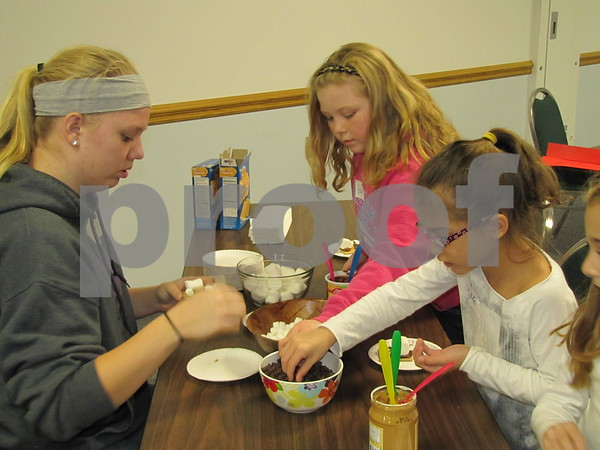 Stephanie Martin leads the kids in making 'Grizzly Bear' treats.