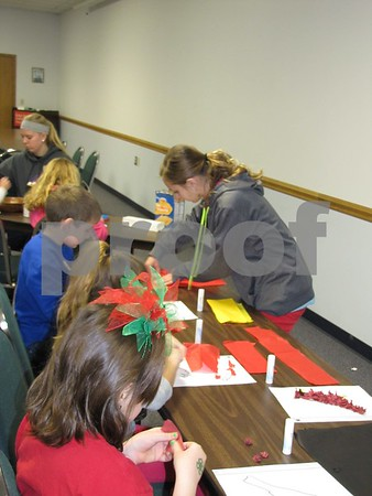 Brooklin Border assisted the children in making decorative paper cardinals.
