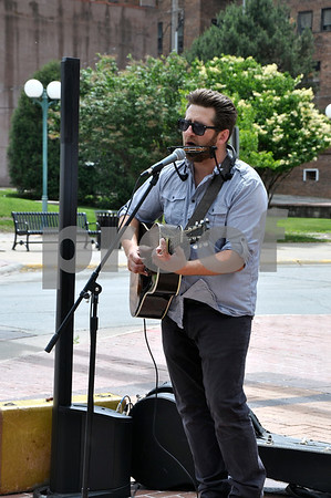 -Messenger photo by Joe Sutter<br /> <br /> Chad Elliott, from Coon Rapids, provided the live music at the market Saturday.