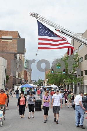 -Messenger photo by Joe Sutter<br /> <br /> The Fort Dodge Fire Department was at Market on Central to hang a giant flag in honor of flag day. Event organizers estimated around 3,000 visitors strolled through the market from 9 a.m. to 1 p.m. Saturday.