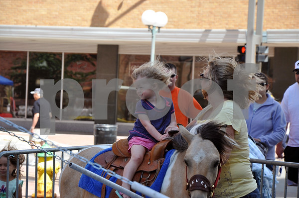-Messenger photo by Joe Sutter<br /> <br /> Laureen Scott, 2 1/2, waits with grandma Lori Algoe, of Fort Dodge, for her pony ride to start at Market on Central Saturday morning.