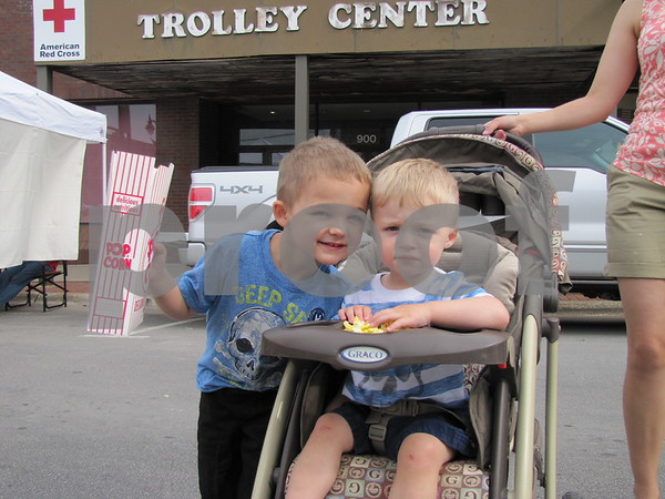Aden and Ethan Tjalsma enjoy the popcorn while attending Market on Central with their mom.