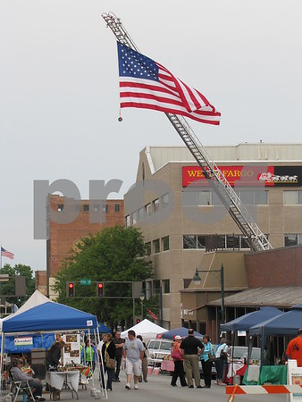 The Fort Dodge Fire Dept. flies the American flag over Market on Central.