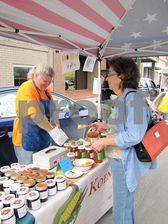 Merrily Dixon makes a purchase of fresh honey from Karen Koenig of Koenigs' Acres.