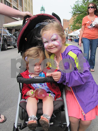 Dylan with big sister Lily Eslick who is all smiles with her face painted.