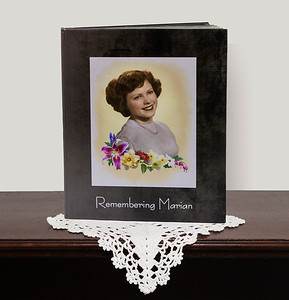 HIGHLIGHTING AN INDIVIDUAL: This beautiful album highlights the life of a dearly beloved mother; her birth, childhood, school, parents and family, marriage, children, up through later life. It is treasured by those who loved and miss her.  Cover Features: This is a very simple basic yet dignified cover design.