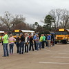 Volunteers line up to pull their buses.