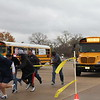 Volunteers pull their buses to try and win the most money.