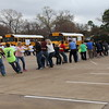 Volunteers pull their buses to try and raise the most money.