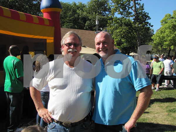 Rick Taylor and Jim Clavin at Community & Family Resources' family fun festival held at Oleson Park.