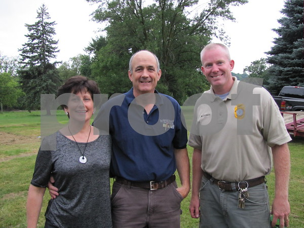 Sandy and Clark Fletcher (Webster County Supervisor), and Matt Cosgrove, Webster County Conservation Director.