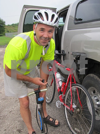 Ben Kohnen does some last minute maintenance before the pedal power poker ride.