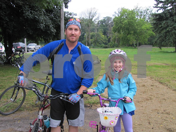 Jeff Delaney and his daughter Katie were all ready to participate in the family bike ride to celebrate the trails.