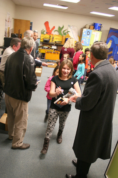 Students receive their dictionaries.