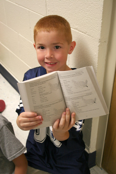 Student shows off their dictionary.