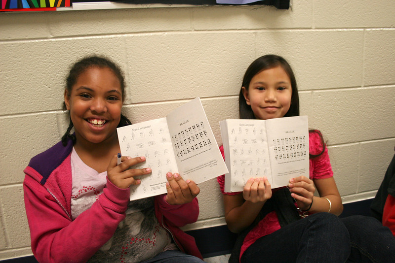 Students show off their dictionaries.