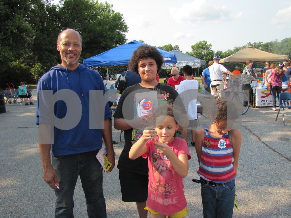 Greg Naylor and his children Marcus, Julianne, and Jassama at the 'Back to School Bash' held in the Corpus Christi parking lot.