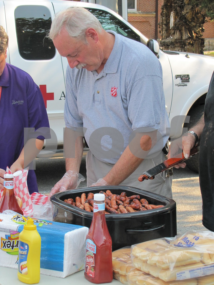 The Salvation Army served hot dogs and all the fixings to attendees at the 'Back to School Bash' held in the Corpus Christi parking lot.